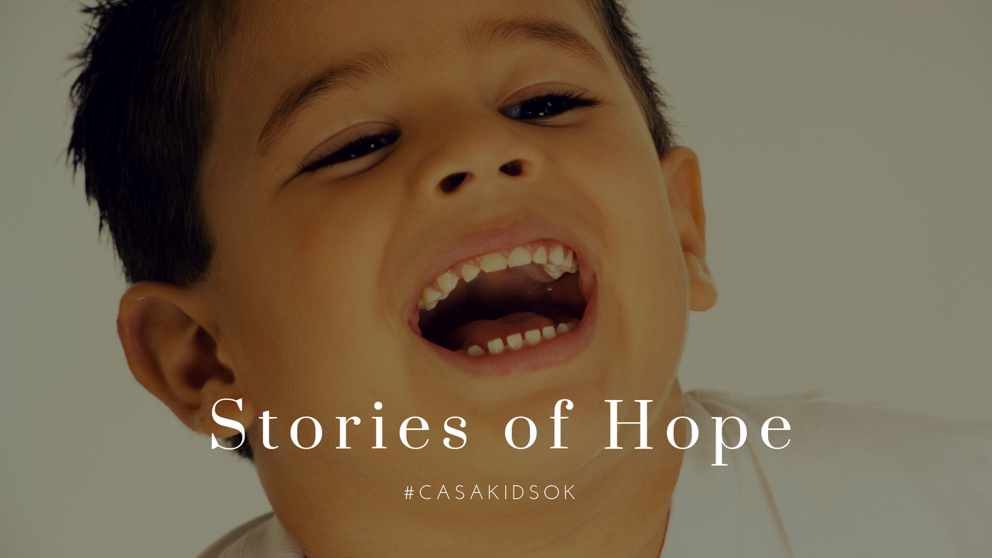Boy Laughing Story of Hope Headline